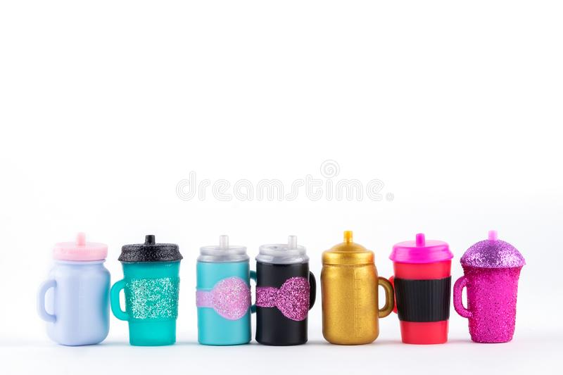 Many mug with a straw for drinking stock photography