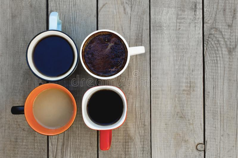 Many cups of coffee on wooden table. royalty free stock images