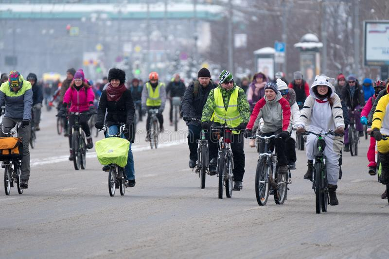 Many cyclists participate in winter bicycle parade around the city centre royalty free stock photo