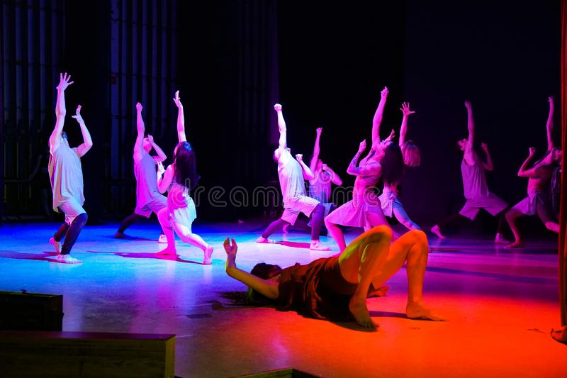 Contemporary dancers on the stage hands and looks up royalty free stock photo