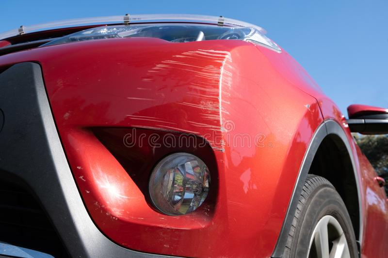 Deep scratches on a vehicle bumper. Many deep scratches on a vehicle bumper royalty free stock image