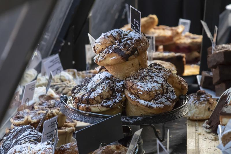 Many Delicious Looking Pastries and Treats on Display at a Market royalty free stock photo