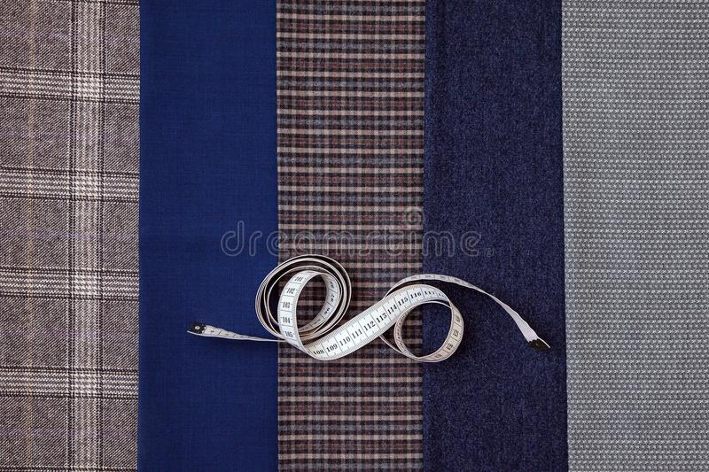Thread fabric wool sewing man cage blue choice design atelier tailor many different things color tape-measure. Many different in color threads lie on the sewing royalty free stock photography