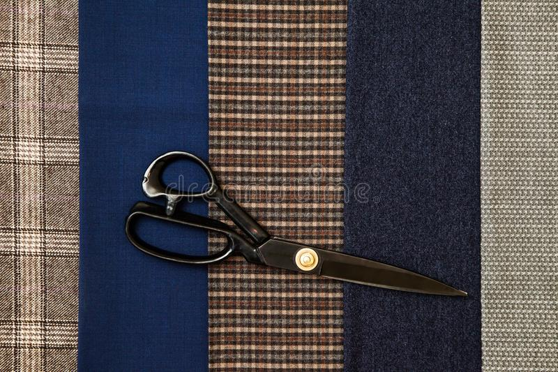 Thread fabric wool sewing man cage blue choice design atelier tailor many different things color scissors. Many different in color threads lie on the sewing stock image