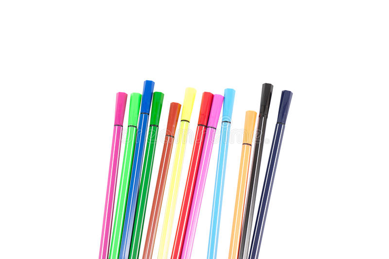 Many different colored pens. Color pencils isolated on a white background. stationery stock image