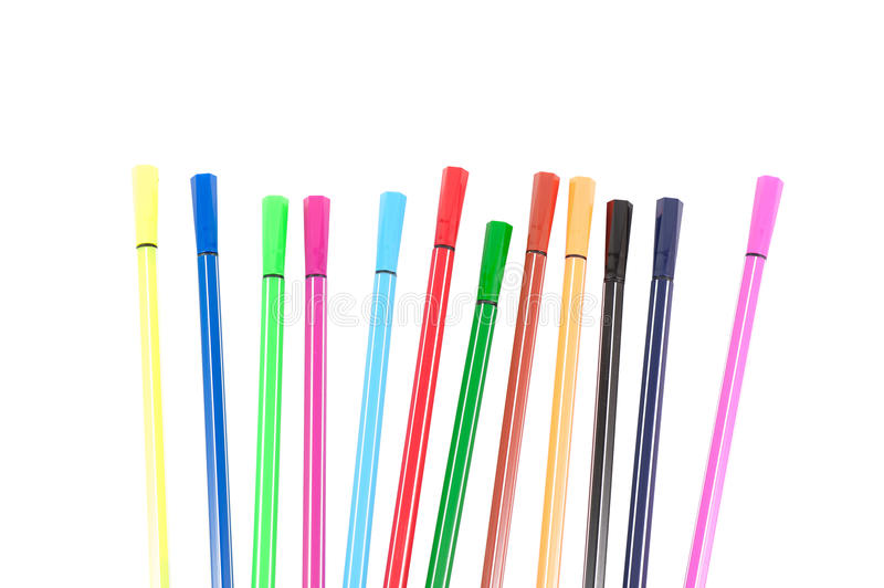 Many different colored pens. Color pencils isolated on a white background. stationery royalty free stock photo