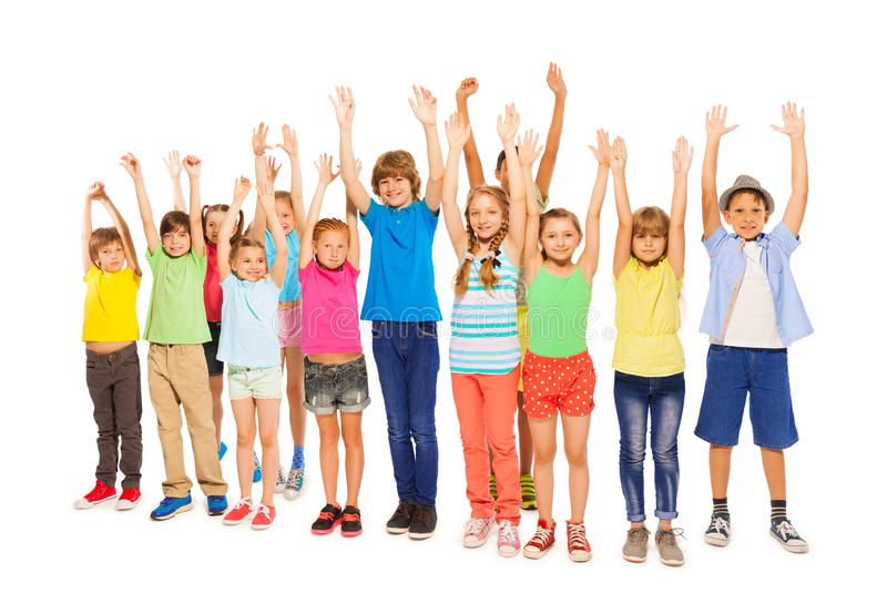Many different kids with raised in the air hands stock photo