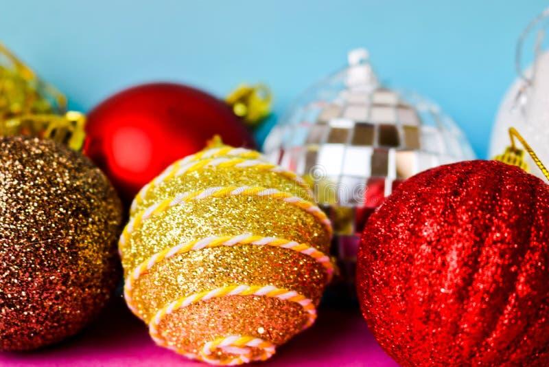 Many different multicolored shiny Christmas decorative beautiful xmas festive Christmas balls, Christmas tree toys background stock image