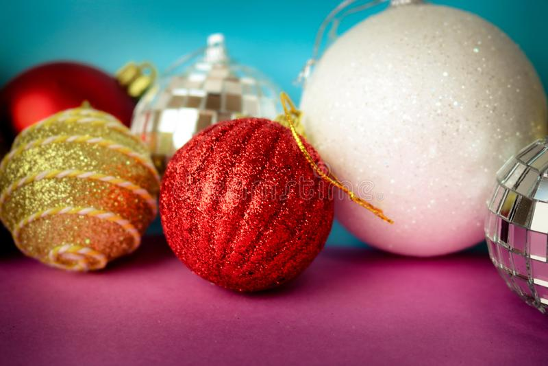 Many different multicolored shiny Christmas decorative beautiful xmas festive Christmas balls, Christmas tree toys background royalty free stock photo