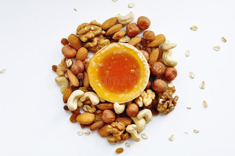 Many different nuts poured into tartlets with honey stock images