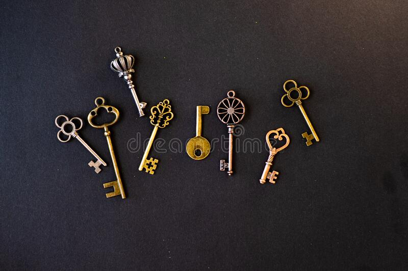 Many different old keys from different locks, scattered chaotically, flat lay. stock photos
