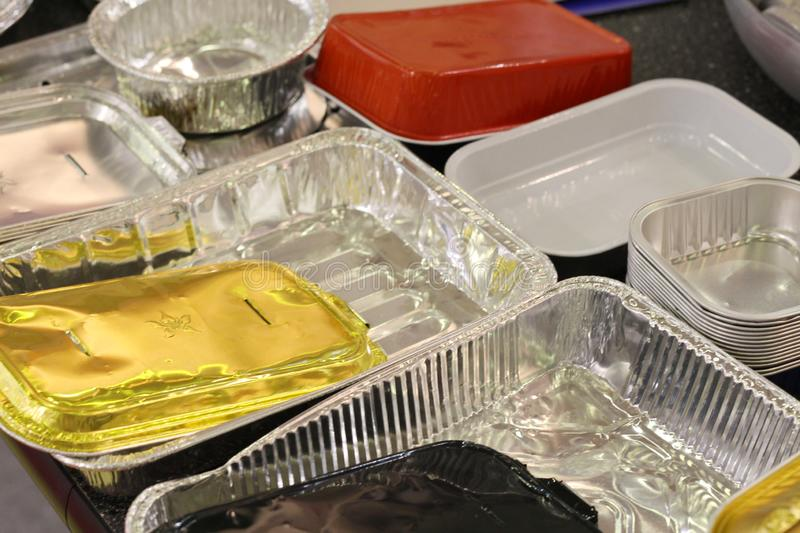 Many different products from aluminum. Aluminum food packaging, Foil royalty free stock images