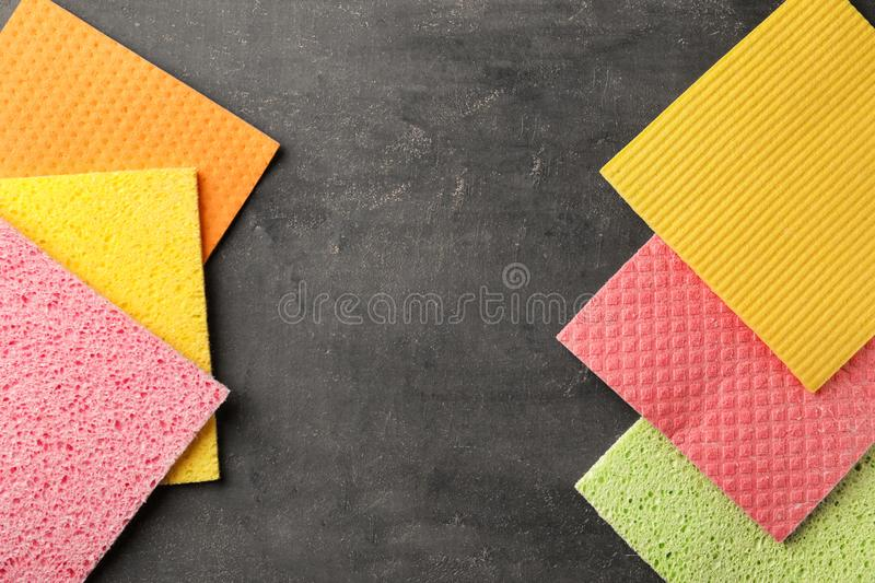 Many different rags for cleaning on grey background, top view stock images