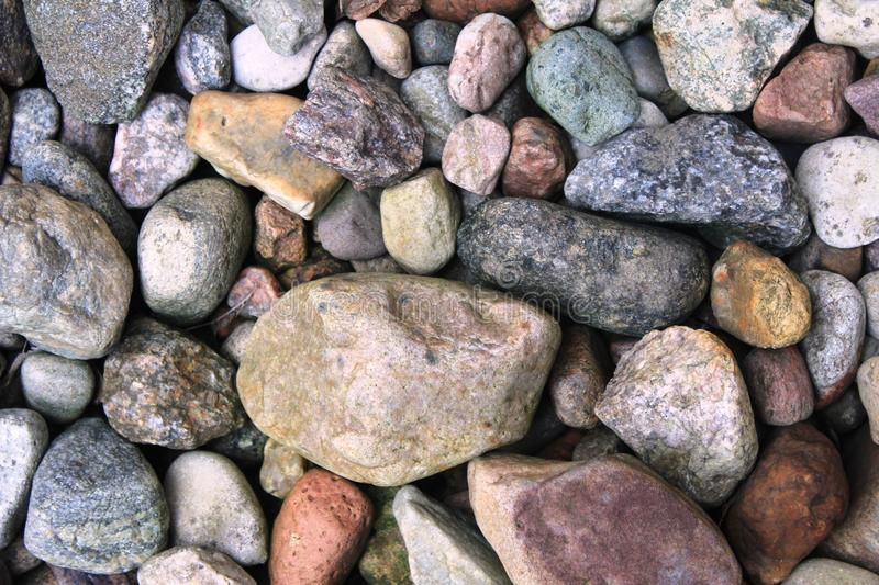Many different stones. Many different shapes and colours of Stones with different ingridients and minerals. Natural products. Stones used for building the paths royalty free stock image