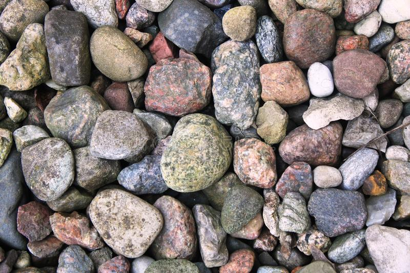 Many different stones. Many different shapes and colours of Stones with different ingridients and minerals. Natural products. Stones used for building the paths royalty free stock images