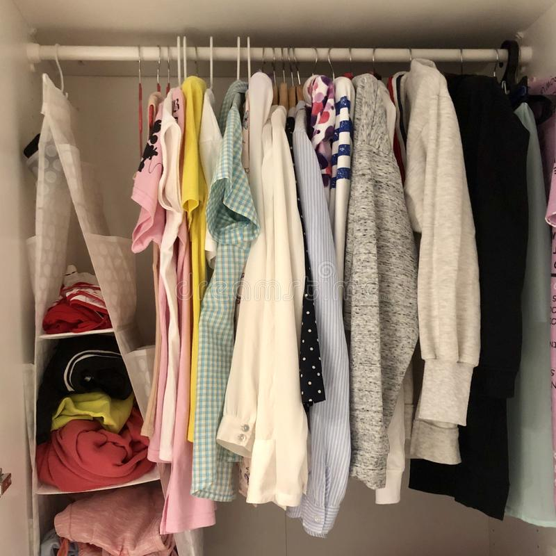 Many different things hang and lie in the closet in the wardrobe. Many different things hang and lie in the closet in the wardrobe stock image