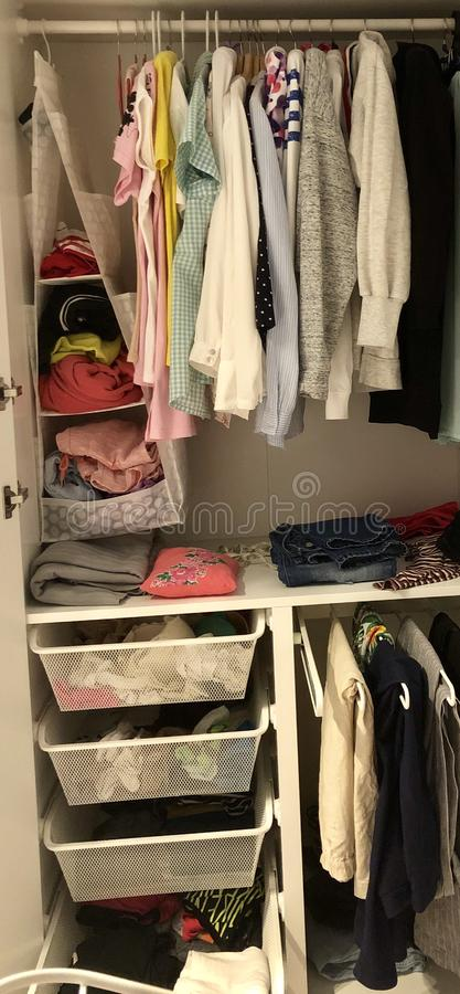 Many different things hang and lie in the closet in the wardrobe. Many different things hang and lie in the closet in the wardrobe royalty free stock images