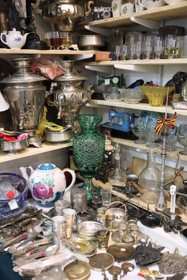 Many different things at the flea market. Many different things: vases, samovar, glasses, spoons at the flea market stock photography