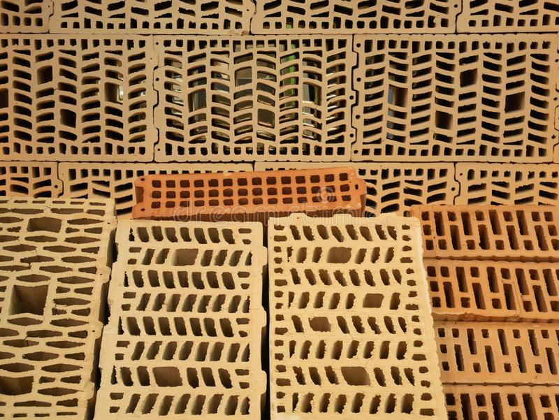 Many different types of construction hollow bricks with patterns inside. samples for sale at diy store warehouse depot stock image