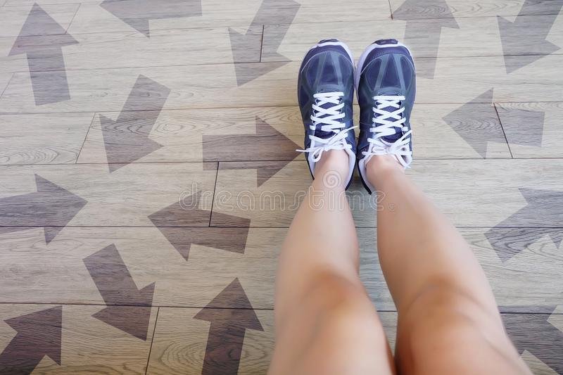 Many Direction Arrow Choices. Selfie of Running Shoes with Drawn Arrows. Woman Violet Sneakers with Decisions on Wooden Floor Back. Ground Great For Any Use stock images