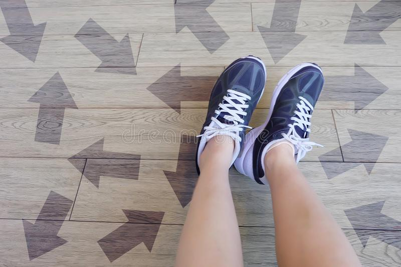 Many Direction Arrow Choices. Selfie of Running Shoes with Drawn Arrows. Woman Violet Sneakers with Decisions on Wooden Floor Back. Ground Great For Any Use stock photography