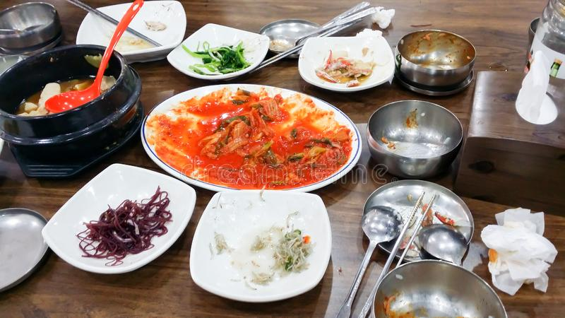 .Many dishes are placed on the table after eating full meals royalty free stock photos