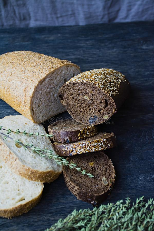 Many diverse bread on a wooden board royalty free stock photography