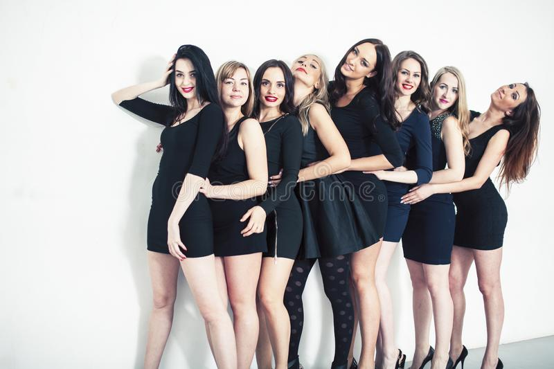 Many diverse women in line, wearing fancy little black dresses, party makeup, vice squad concept lifestyle. Closeup royalty free stock photography