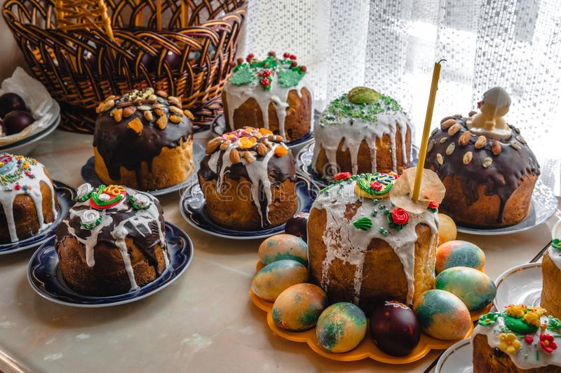 Many Easter cake and painted eggs on wooden table. Festive composition in rustic style, Springtime. Flat lay, top view background royalty free stock photography