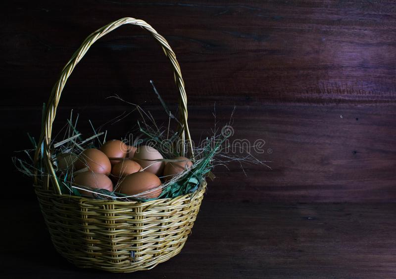 Many eggs in the wicker basket. stock photography