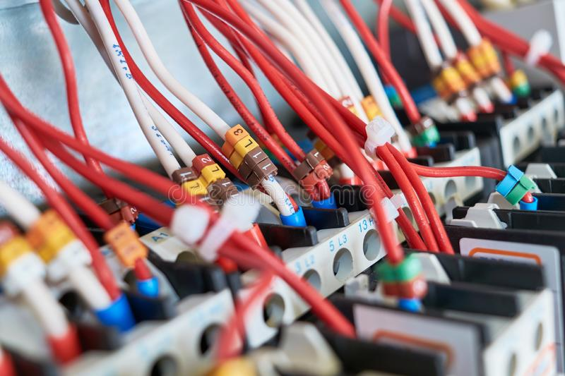 Many electrical wires or cables are connected to magnetic starters stock image