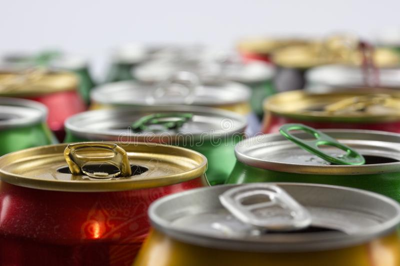 Many empty cans. Recycling, a lot of recycled cans made from aluminum. are being prepared for re-production. A lot of opened soda, stock photography