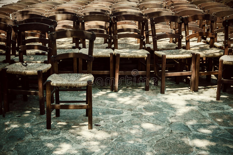 Many empty chairs waiting as background. Soft focus stock image