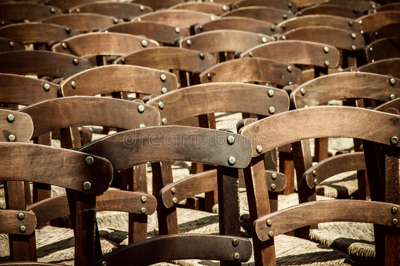 Many empty chairs waiting as background. Soft focus royalty free stock images