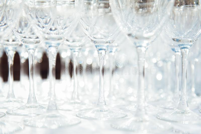 Many empty champagne glasses on the table royalty free stock images