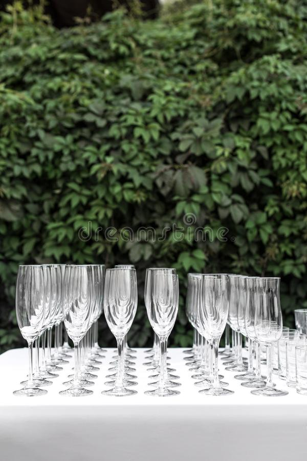 Many empty clean glasses for guests at the buffet festive wedding table royalty free stock image