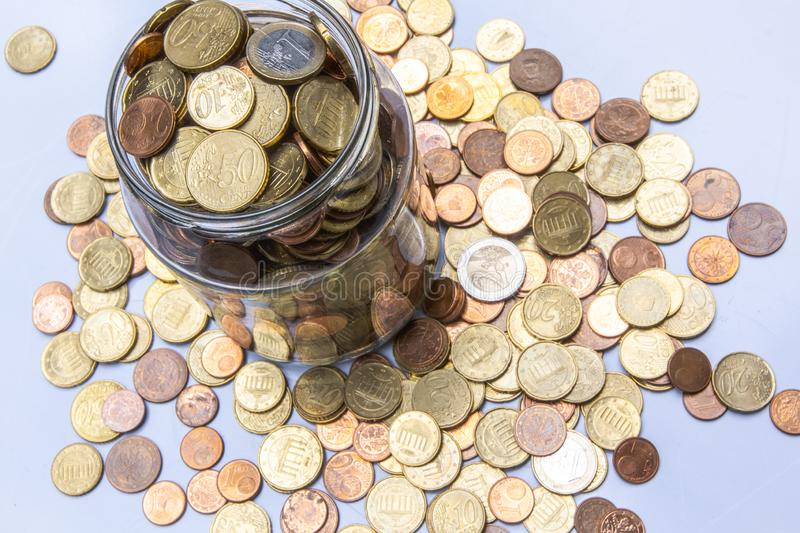 Many euro coins in glass on white background save money royalty free stock photo