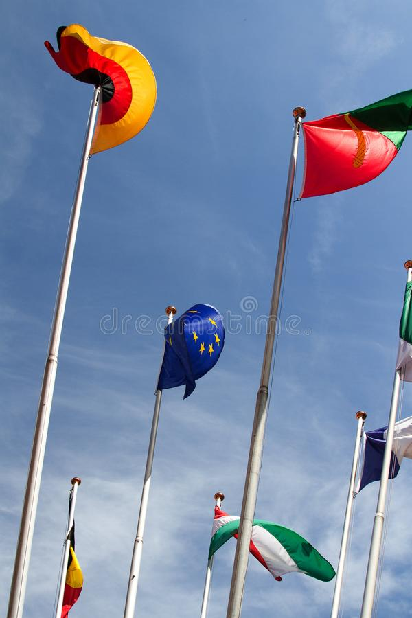 Many europeans flags in the wind against the sky stock images