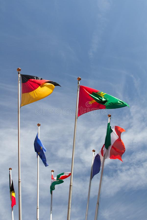 Many europeans flags in the wind against the sky stock photos