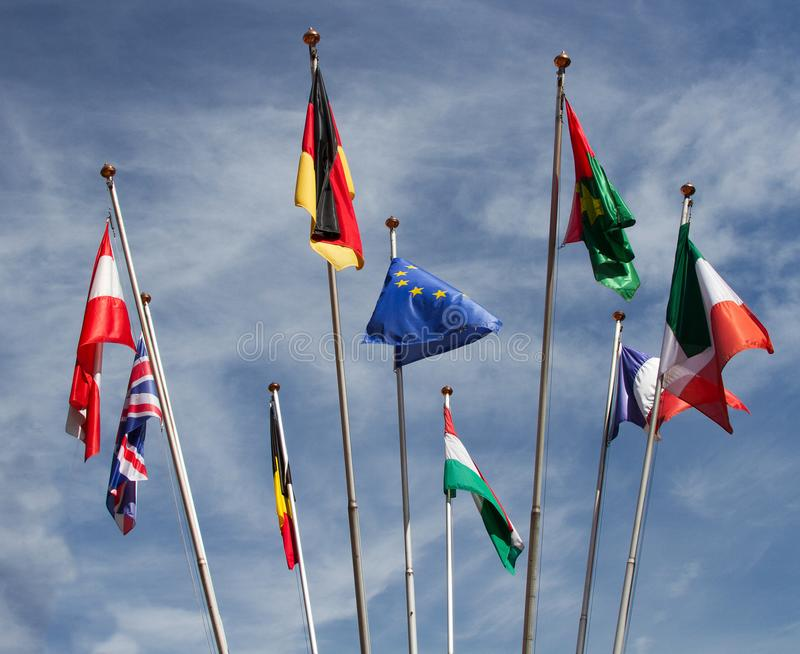 Many europeans flags in the wind against the sky royalty free stock photo