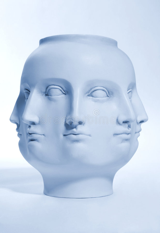 Many Faces. A sculpture of many faces - many metaphorical uses