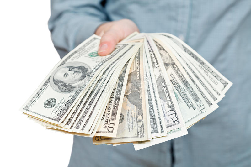 Many fanned dollars banknotes in hand stock images