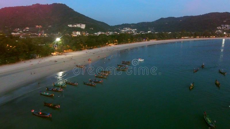 Many fishing boats are on moorage near beach at the evening. Professional shot in 4K resolution. 074. You can use it e.g. in your commercial video, travel stock image