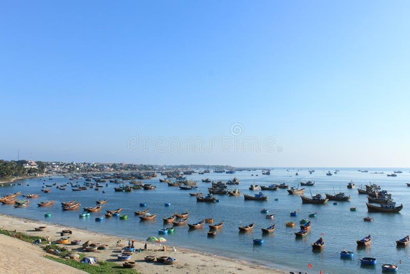 Many fishing boats in Mui Ne harbor , Vietnam royalty free stock photo