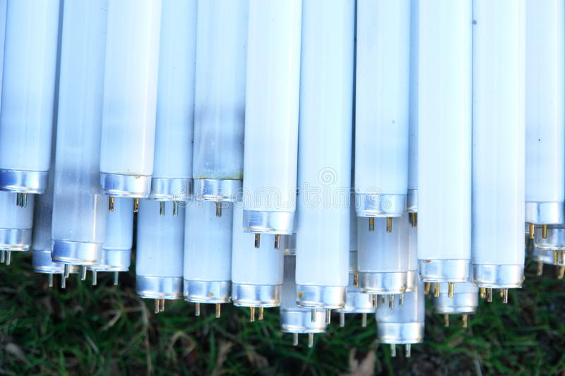 Many fluorescent neon tube lamps. Close-up of a lot of neonlamps stock images