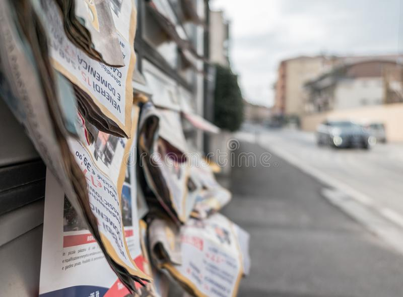 Many flyers in mailboxes. Symbol for advertising, marketing, spam. Selective focus stock image