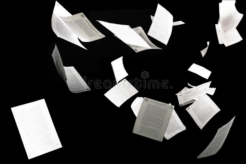 Many flying business documents isolated on black background royalty free stock images