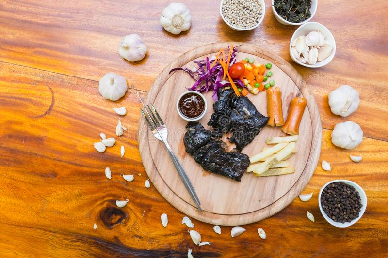 Many food on table. Steak black chicken on wood dish stock photos