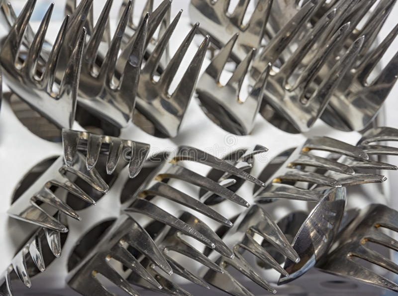 Many forks. In box of dishwasher. Top view royalty free stock image