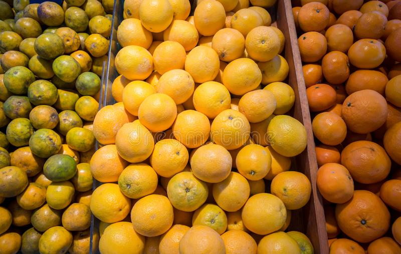 Many fresh and beautiful Oranges with a good taste in the basket at the market royalty free stock photo